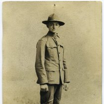 Image of Sepia-tone photo of William Beck posed in his U.S. Army uniform, n.p.,1918. - Photograph