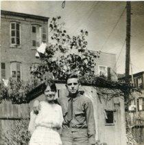Image of B+W photo of Rose Beck & fiance George Jaxel in his U.S. Army uniform, backyard garden, 600 Monroe St.?, Hoboken, Sun., Aug. 18, 1918. - Photograph