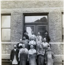 Image of 15 Newark exterior, 9 to 17 Saint Francis St.; men with work aprons outside