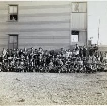 Image of 16 Newark(?), large group of workers posed outside housing