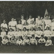 Image of B+W photo of Our Lady of Grace School group photo of girls & boys with Mabel Bolles, Hoboken, n.d., ca. 1907. - Print, Photographic