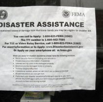 Image of Img_3909 typical Disaster Assistance flier posted in window
