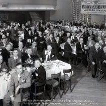"""Image of B+W panoramic photo of men at 4th Anniversary """"20 Year Club"""", Janssen Division, Philadelphia Dairy Products Co., Inc. Union Club, Hoboken, N.J., Nov. 18, 1954. - Print, Photographic"""