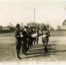 Image of B+W photo of Stevens Institute of Technology students receiving diplomas in their Army uniforms at commencement during WWI, Hoboken, ca. Apr. 6-7, 1918. - Print, Photographic