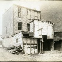 Image of Sepia-tone photos, 4, of an old wood framed building on site of R. Neumann & Co., Hoboken, n.d., ca. 1917-1918. - Print, Photographic
