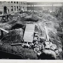 Image of B+W photos, 2, of foundation work for new factory building at R. Neumann & Co., Ferry St. west of Willow Ave., Hoboken, July 3, 1919. - Print, Photographic
