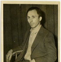 Image of B+W photo of Joseph Scutellaro after his arrest for murder of Harry L. Barck, Overseer of the Poor, Hoboken, February 25, 1938.  - Print, Photographic