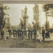 Image of Sepia-tone photo of military ceremony at Civil War Soldiers Monument, Hudson Square Park, Hoboken, n.d., probably May 1905. - Print, Photographic