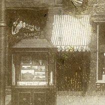 Image of detail lower left: Magnus street display, entrance awning