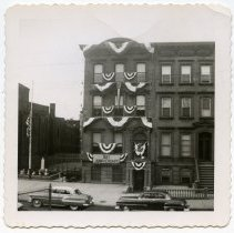 Image of B+W photo of Knights of Columbus clubhouse decorated for 60th anniversary, 716 Hudson St., Hoboken, Apr. 16, 1956. - Print, Photographic