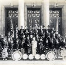 Image of Sepia-tone photo of OLG Fife, Drum & Bugle Corps posed on steps at Demarest High School main entrance, Garden St., Hoboken, n.d., ca. 1935-1945. - Print, Photographic