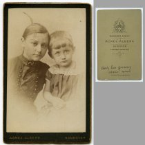 Image of 2: young woman or girl with girl or boy ca. 3-5 years old