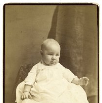 Image of Cabinet photo of a baby posed in photographer's studio, a member of or related to the Sanntrock family of Hoboken; Hoboken, n.d., ca. 1884-1892. - Photograph, Cabinet
