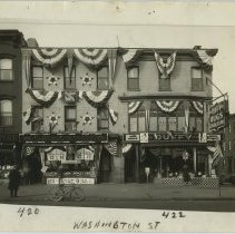 Image of B+W photo of 420 & 422 Washington Street decorated with bunting and swagging by United Decorating Company of Hoboken, Hoboken, n.d., ca. mid-Oct. 1933. - Print, Photographic