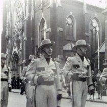 Image of B+W photo of James Radigan marching in Holy Name Day Parade with Lenape Lancers, O.L.G. Senior Drum Corps, Hoboken, Oct. 1951. - Print, photographic