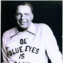Image of B+W repro of inscribed photo of Frank Sinatra in sweatshirt: Ol' Blue Eyes is Back. N.p., n.d., ca. 1973.