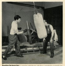 Image of detail pg 62, bottom photo: Punching the heavy bag (home gymasium)