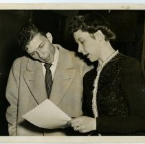 Image of Sinatra photo: Frank Sinatra reviewing document with Chief Clerk at Local Draft Board No. 3, 160 Danforth St., Jersey City , N.J. Dec. 9, 1943.  - Print, Photographic