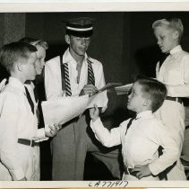 Image of Sinatra photo: Frank Sinatra giving autographs to four of Bing Crosby's sons, N.Y., Sept. 15, 1945.  - Print, Photographic