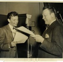 Image of Sinatra photo: Frank Sinatra & Fred Allen in radio studio rehearsing at microphone with scripts, n.p. (N.Y.), November 26, 1946.   - Print, Photographic