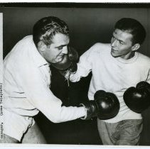 Image of Sinatra photo: Frank Sinatra sparring in boxing gloves with Bobby Weitman, New York, April 4, 1947.  - Print, Photographic