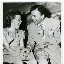 Image of Sinatra photo: Frank Sinatra with young fan Ruth Aase at Idlewild Airport, N.Y., after returning from London, July 25, 1950.  - Print, Photographic