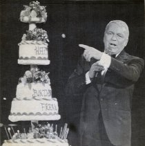 Image of B+W wirephoto of Frank Sinatra onstage with birthday cake at Bally's Grand Hotel, Atlantic City, NJ, Dec. 13, 1987. - Print, Photographic