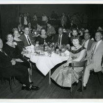 Image of B+W group photo of Union Club owner Joseph Samperi, family & friends (Sinatra's parents?) at table, Union Club, Hoboken, N.J., n.d., ca. 1948-1950. - Print, Photographic