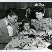 Image of B+W photo of Frank Sinatra, wife Nancy & daughter Nancy at Stork Club, N.Y., n.d., ca. 1946-1947. - Print, Photographic