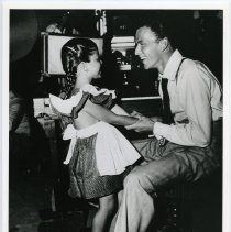 Image of B+W photo of Frank Sinatra with daughter Nancy, in a radio or film studio, n.p., n.d., ca. 1945.  - Print, Photographic