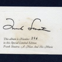 Image of slipcase: back detail of signed label and limitation