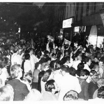 Image of B+W photo of Tom Vezzetti supporters outside his campaign headquarters, 536 Washington St., on election night, Hoboken, [June 11, 1985]. - Print, Photographic