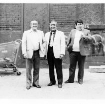 Image of B+W photo of mayoral candidate Tom Vezzetti and two unidentified men at unidentified location, Hoboken, no date, ca. June 1985. - Print, Photographic