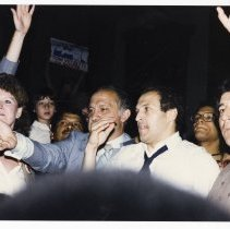 Image of Color photo of mayoral candidate Tom Vezzetti in front of City Hall with supporters on election night, Hoboken, [June 11, 1985]. - Print, Photographic