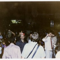 Image of Color photo of supporters of mayoral candidate Tom Vezzetti in front of City Hall on election night, Hoboken, [June 11, 1985]. - Print, Photographic