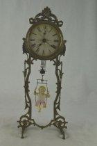 Image of Bobbing clock doll