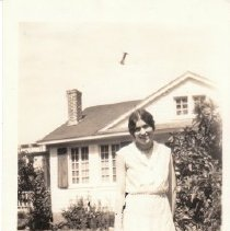 Image of 2009.2.6 - Young lady in front of house