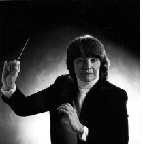 Image of Joyce Hamilton-Johnson with a conductor's baton.
