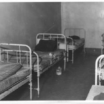 Image of 2011.61.1104 - Beds at the old jail prior to the jail's demolition in 1975.