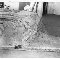Image of 2011.61.1110 - Discarded mattresses at the old jail prior to the jail's demolition in 1975.