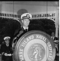 Image of 2011.61.1271 - Captain Willis Barnes addressing a gathering at the Mare Island Naval Shipyard.