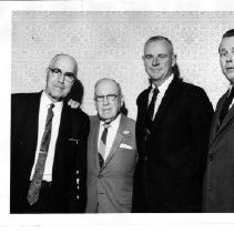 Image of 2011.61.1413 - Dr. Dwight H. Murray Sr., second from left, with three unidentified men.