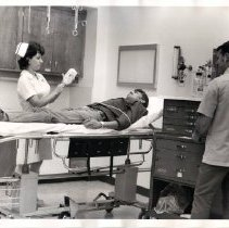 Image of Health care workers administer to a patient, St. Helena Hospital