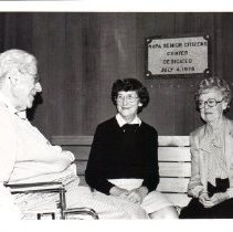 Image of 2011.61.2474 - Dorothy Searcy sitting with an unidentified man and woman at the Napa Senior Citizens Center.