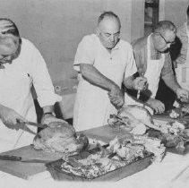 Image of Men carving at Fancy Fair