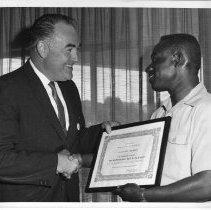 Image of Rep. Don Clausen receives honorary membership