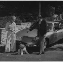 Image of 2011.61.585 - Mr. and Mrs. Peter Knowles with their Ferrari and dog