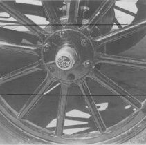 Image of 2011.61.588 - Closeup of wheel and hub of antique car