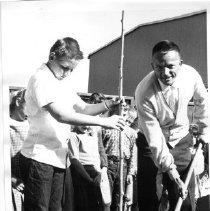 Image of 2011.61.669 - Robert H. Cudaback with shovel