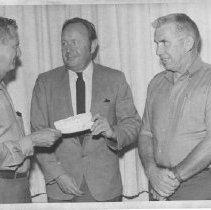 Image of John Dunlap presenting a check